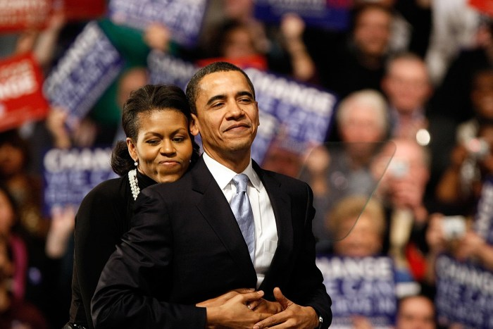NASHUA, NH - JANUARY 08:  Democratic presidential hopeful Sen. Barack Obama (D-IL) is hugged by his wife Michelle Obama before his speech at a primary night rally in the gymnasium at the Nashua South High School on January 8, 2008 in Nashua, New Hampshire. Obama finished a projected 2nd place behind Sen. Hillary Clinton (D-NY) in the nation's first democratic primary (Photo Credit: Win McNamee/Getty Images)