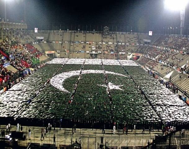Pakistani youths make the biggest human national flag at the National Hockey Stadium in Lahore