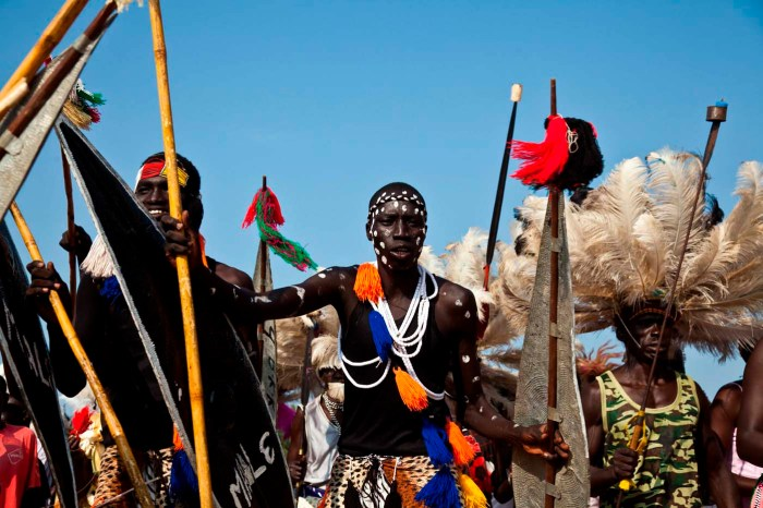 """Traditional dancers perform during celebrations to mark the first anniversary of the Republic of South Sudan's independence in the capital Juba, July 9, 2012. South Sudan's President Salva Kiir vowed on Monday to confront the corruption plaguing his country a year after it declared independence and said the new nation's economy still had to be """"liberated"""" from its dependence on foreign powers. (Photo Credit: REUTERS/Adriane Ohanesian)"""