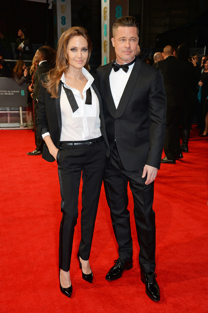 Angelina Jolie (in Saint Laurent) and Brad Pitt