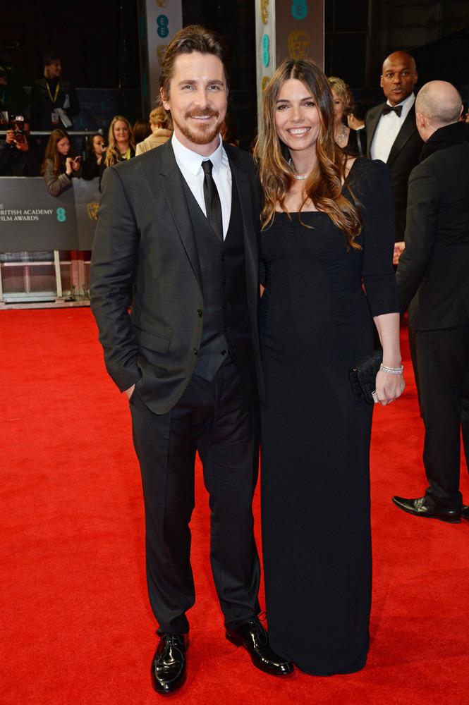 Christian Bale (in Dolce & Gabbana) and Sibi Blazic
