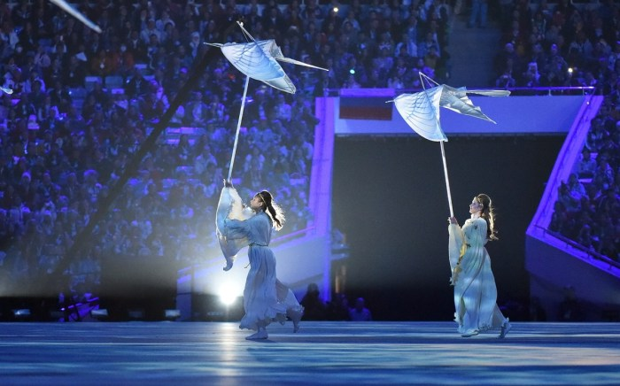 Dancers perform at the start of the Closing Ceremony of the Sochi Winter Olympics at the Fisht Olympic Stadium on February 23, 2014. AFP PHOTO / DAMIEN MEYER (Photo credit should read DAMIEN MEYER/AFP/Getty Images)