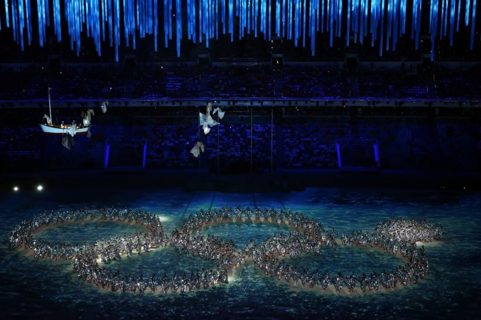 SOCHI, RUSSIA - FEBRUARY 23: Dancers form the Olympic rings during the 2014 Sochi Winter Olympics Closing Ceremony at Fisht Olympic Stadium on February 23, 2014 in Sochi, Russia. (Photo by Matthew Stockman/Getty Images)