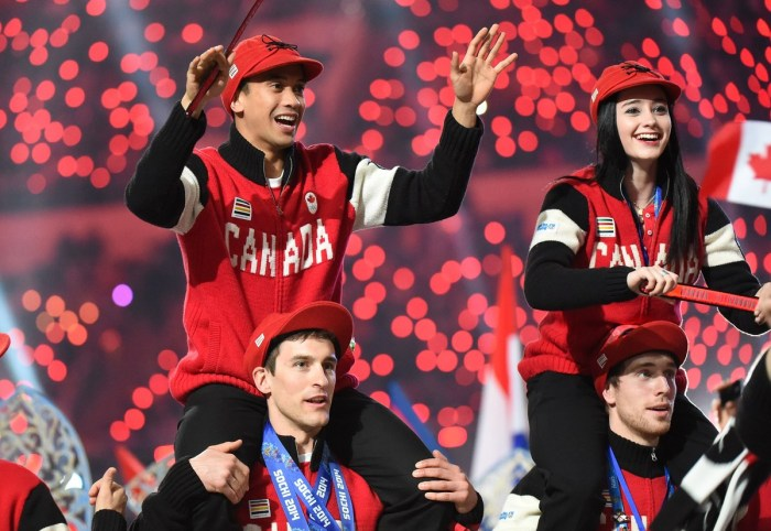 Canada's figure skater Kaetlyn Osmond (top R) and speed skaters Denny Morrison (bottom L) and Gilmore Junio (top L) parade during the Closing Ceremony of the Sochi Winter Olympics at the Fisht Olympic Stadium on February 23, 2014. AFP PHOTO / DAMIEN MEYER (Photo credit should read DAMIEN MEYER/AFP/Getty Images)