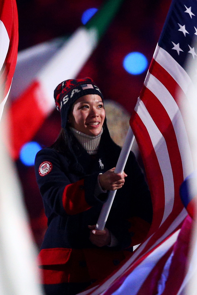 SOCHI, RUSSIA - FEBRUARY 23: Hockey player Julie Chu of the United States enters with the flag during the 2014 Sochi Winter Olympics Closing Ceremony at Fisht Olympic Stadium on February 23, 2014 in Sochi, Russia. (Photo by Paul Gilham/Getty Images)