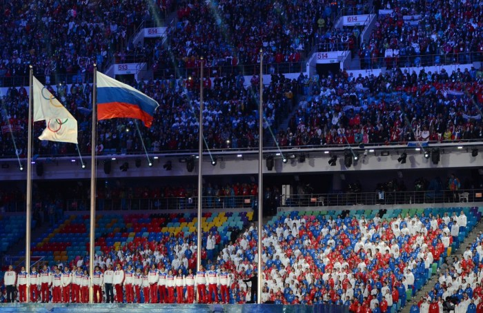 Russian athletes listen to their national anthem as they take part in the Closing Ceremony of the Sochi Winter Olympics at the Fisht Olympic Stadium on February 23, 2014. AFP PHOTO / KIRILL KUDRYAVTSEV (Photo credit should read KIRILL KUDRYAVTSEV/AFP/Getty Images)