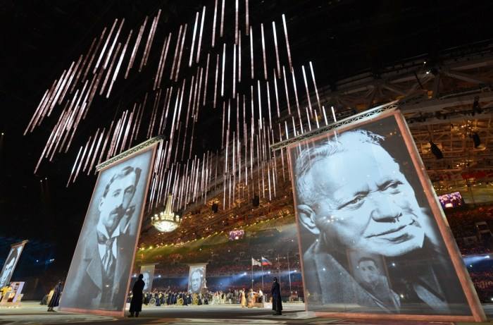 Performers stand next to giant portraits of famous Russian writers during the Closing Ceremony of the Sochi Winter Olympics at the Fisht Olympic Stadium on February 23, 2014. AFP PHOTO / KIRILL KUDRYAVTSEV (Photo credit should read KIRILL KUDRYAVTSEV/AFP/Getty Images)