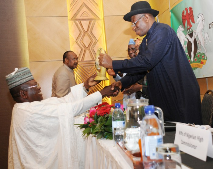 PRESIDENT GOODLUCK JONATHAN RECEIVING A SOUVENIR FROM THE PRESIDENT, NIGERIAN COMMUNITY IN NAMIBIA, MR BUBA MADUGU, AT A MEETING OF PRESIDENT JONATHAN WITH NIGERIANS IN NAMIBIA ON THURSDAY.