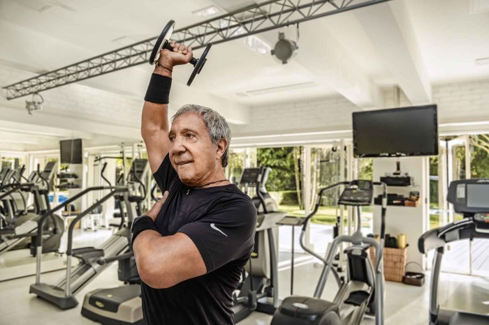 To combat the loss of muscle mass that comes with old age, Diniz, in his commodious home gym, lifts moderate amounts of weight at high speed before adding bigger loads. (Photo Credit: Olaf Blecker/ Bloomberg Pursuits)