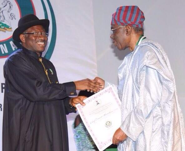 President Jonathan presenting a centenary award to former head of the interim national govt. Chief Ernest Shonekan.