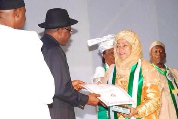 President Jonathan presenting a centenary award to former 1st lady Maryam Abacha, who represented the late Gen Abacha.