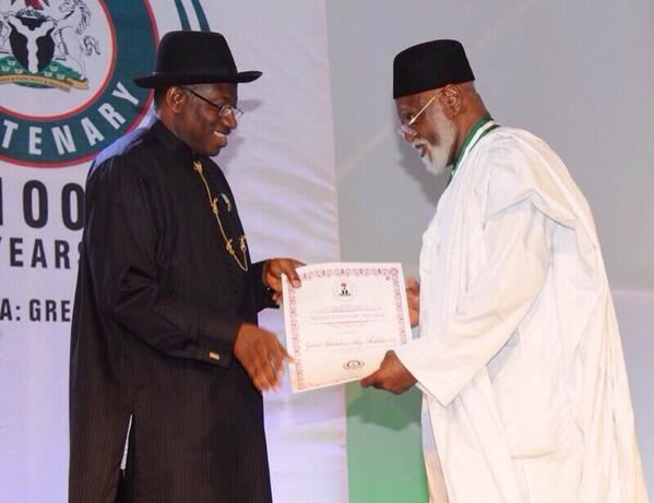 Former Head of State, Gen. Abdulsalami Abubakar, receiving his centenary award from President Jonathan.