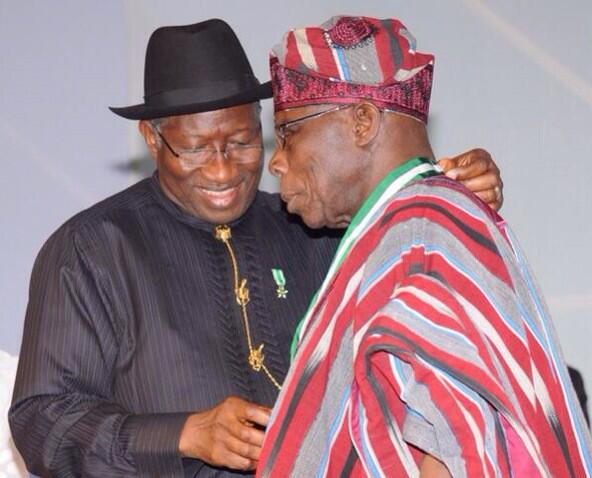 Former President Obasanjo receiving his award from President Jonathan at the Centenary Awards ceremony