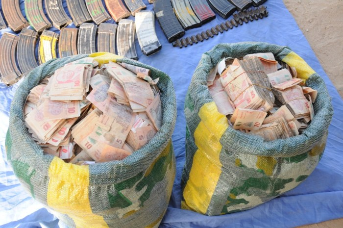 Arms and money recovered from terrorists