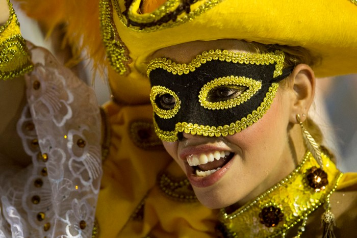 A performer from the Academicos do Salgueiro samba school during carnival celebrations at the Sambadrome, on February 10, 2013. (AP Photo/Felipe Dana)
