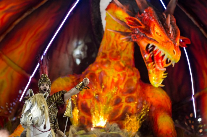 A dragon rises behind a performer from the Beija Flor samba school in Rio, on February 12, 2013. (AP Photo/Felipe Dana)