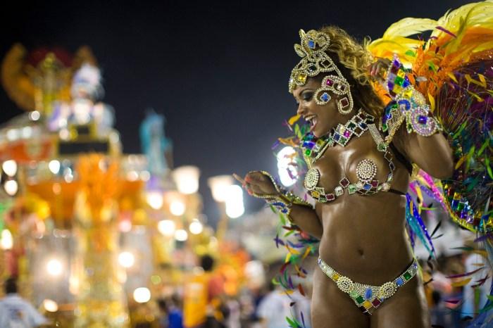 A performer from the Beija Flor samba school, at the Sambadrome, on February 12, 2013. (AP Photo/Felipe Dana)
