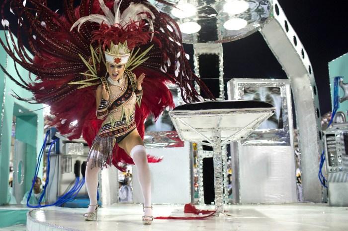 A performer from the Academicos do Grande Rio samba school, in the Sambadrome in Rio, on February 12, 2013. (AP Photo/Felipe Dana)