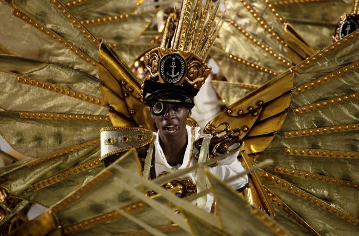 Performers from the Academicos do Grande Rio samba school, in Rio's Sambadrome, on February 12, 2013. (AP Photo/Hassan Ammar)