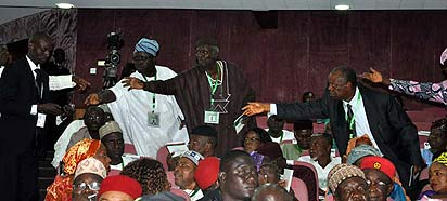 Delegates reaching for the microphone at conference. PHO