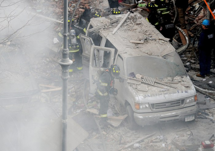 Firefighters work at the scene of a building collapse in New York City on March 12, 2014. (Justin Lane—EPA)