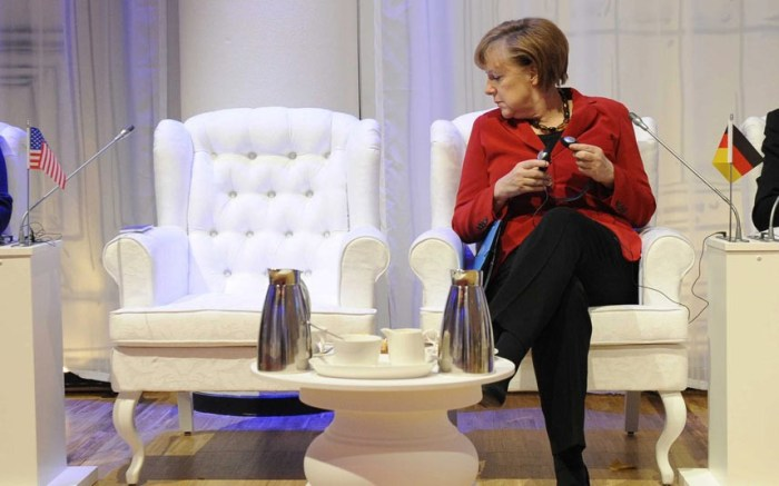 German Chancellor Angela Merkel looks at US President Barack Obama's empty seat ahead of an informal meeting within the Nuclear Security Summit, in The Hague, The Netherlands (Photo Credit: EPA/JOHN THYS)
