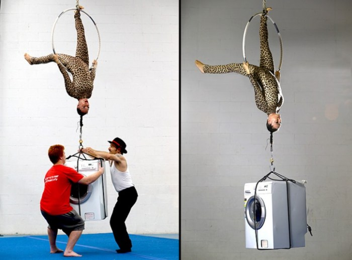 Definitely don't try this at home... Aerial acrobat Simone Genziuk lifts a 75kg washing machine with her hair while hanging upside down from a hoop. Luckily for Simone, the machine wasn't on a spin cycle. (Photo Credit: REX FEATURES)