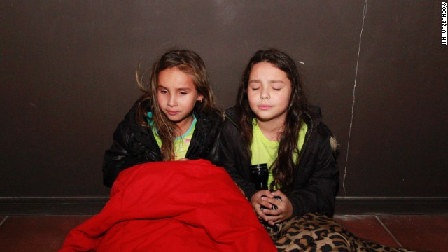 Girls wait in a hallway before evacuating Iquique on April 1. A tsunami warning was in effect for Chile, Peru, Ecuador, Colombia and Panama. (Photo Credit: CNN)