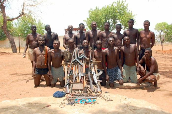 A snapshot of the suspected terrorists arrested in Taraba by the Nigerian military released by Defense Headquarters on April 23, 2014. The terrorists are pictured with their arms and charms. (DHQ Photo)