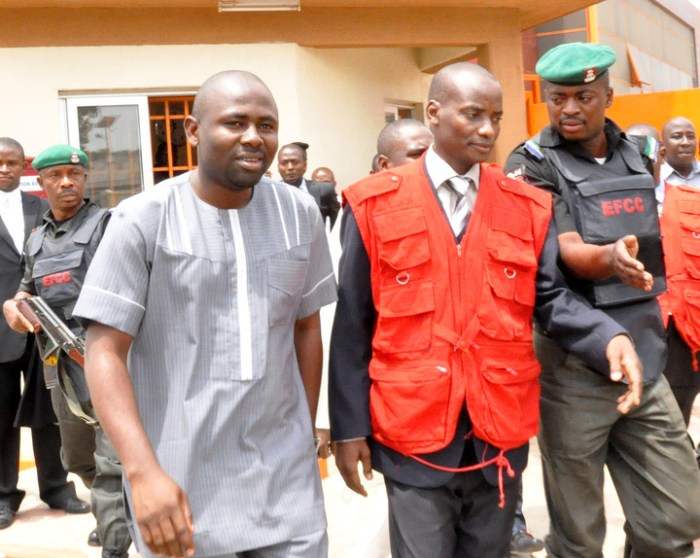 Former Chairman, House Committee on Capital Markets, Rep. Herman Hembe being  led by officials of the EFCC when he appeared at the High Court on charges of fraud in Abuja, Thursday, May 17, 2012. (iPhoto)