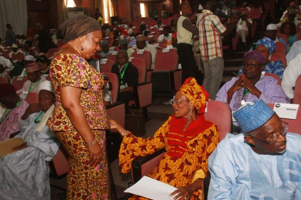 Senator Florence Ita Giwa (Standing) sharing a word with Prof. Dora Akunyili at the National Conference in Abuja (Internet Photo)