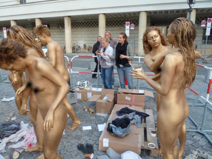 Nudists painting their bodies