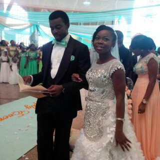 The bride and groom, Faith and Godwin in church (Photo Credit: Cynthia Oboho)