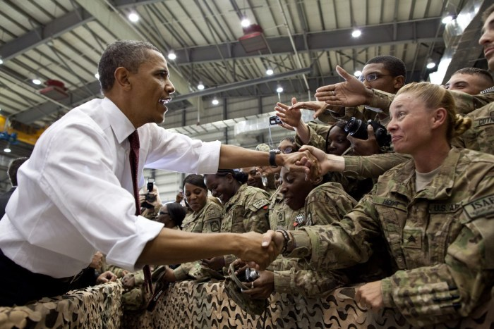 President Barack Obama greets U.S. troops following his remarks at Bagram Air Field, Afghanistan, May 1, 2012. (Official White House Photo by Pete Souza) This official White House photograph is being made available only for publication by news organizations and/or for personal use printing by the subject(s) of the photograph. The photograph may not be manipulated in any way and may not be used in commercial or political materials, advertisements, emails, products, promotions that in any way suggests approval or endorsement of the President, the First Family, or the White House.