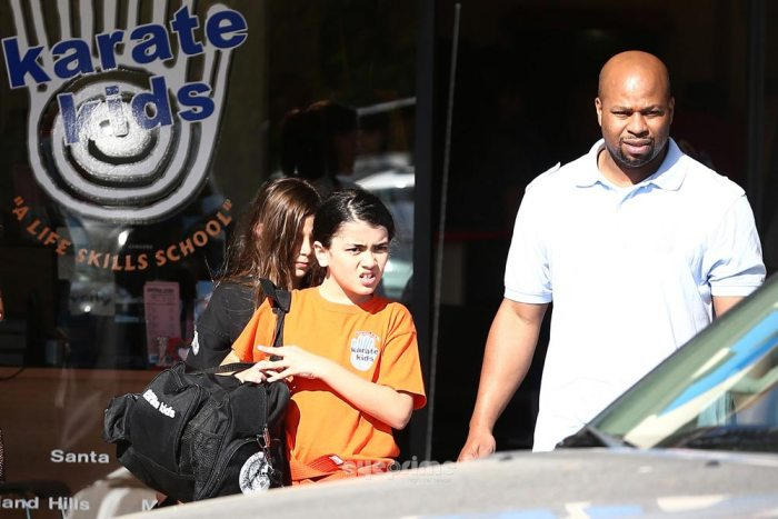 Blanket Jackson and body guard pictured at the Karate Dawn in Encino on May 2013