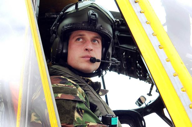Daddy cool: Prince William in Sea King helicopter