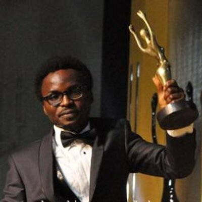 Director, Eric Aghimien receiving the Prize for Achievement in Visual Effects at the 2014 Africa Movies Academy Awards (AMAA)