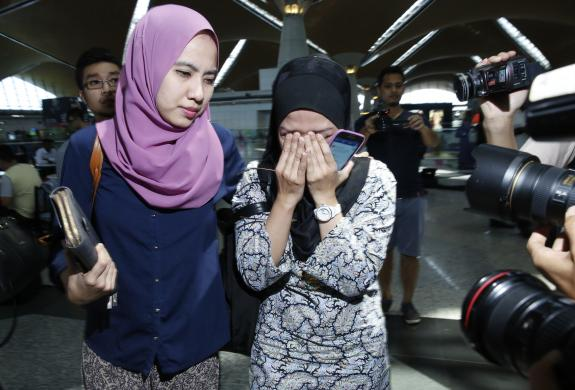 Relatives of passengers on board Malaysia Airlines flight MH17 arrive at Kuala Lumpur International Airport in Sepang July 18, 2014. [Photo Credit: REUTERS/Olivia Harris]