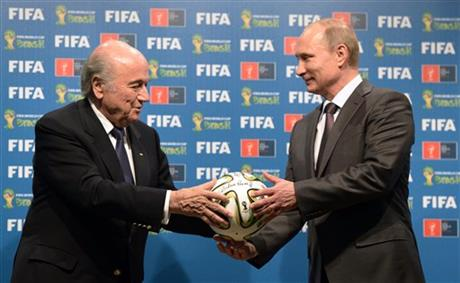 In this file photo taken on Sunday, July 13, 2014, FIFA President Sepp Blatter, left, and Russian President Vladimir Putin hold a soccer ball during the official ceremony of handover to Russia as the 2018 World Cup hosts, after the World Cup final soccer match between Germany and Argentina at the Maracana Stadium in Rio de Janeiro, Brazil. (AP Photo/RIA-Novosti, Alexei Nikolsky, Presidential Press Service, File)