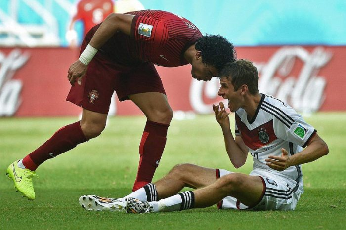 Pepe (Portugal) fouls Germany's Thomas Mueller and is sent off of the field. Source: The Star