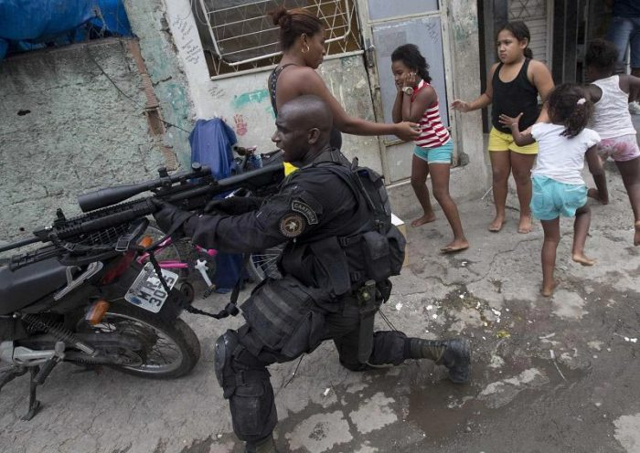 Troops raid a pre-World Cup Rio de Janeiro to reduce violent activity in the city's slums. Source: Business Insider
