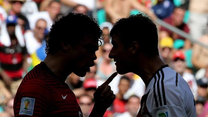 Portugal's Pepe gets a yellow card after arguing with Thomas Muller in the game against Germany. Source: USA Today