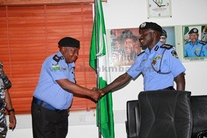 CP Dan Bature receiving a congratulatory hand shake from the IGP after he was decorated with his new rank as Commissioner of Police. [Photo Credit: frankmba.com]