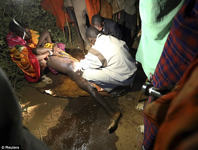 A dozen men have been forced to undergo circumcisions in western Kenya. File picture shows a male Masai as he is circumcised by a nurse during an initiation ceremony in the village of Eremit in 2012 (Photo credit: Daily Mail UK)