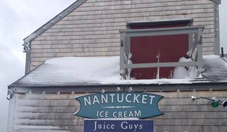 Griffin climbed the Juice Guys building in Nantucket before jumping off the wharf (Photo credit: Facebook)