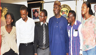 Lagos State Governor, Babatude Fashola (third right), flanked by five survivors of the Ebola virus: Dr. Kelechi Enemuo (left), Dr. Ibeawuchi Morris (secondleft), Dr Fadipe Akinniyi (third left), Mr. Dennis Akagha (second right) and Dr. Adaora Igonoh (right), during their visit to the governor at the Lagos State. [Photo Credit: Thisday]