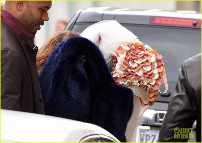 November 16, 2014: Beyonce, Jay Z, and Blue Ivy arrive to the wedding venue for Beyonce's sister Solange's wedding to Alan Ferguson in New Orleans.  Blue Ivy looks to be dressed as a flower girl while Beyonce covers her head behind colorful flower petals. (Photo Credit: INFphoto.com)