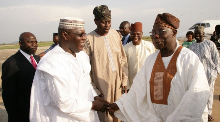Olusegun obasanjo and Atiku Abubakar exchange greetings in Minna, Niger State on Tuesday, November 4, 2014 (Photo Credit: The Scoop)