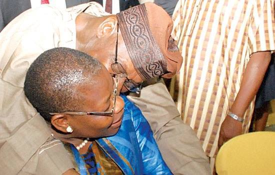 Olusegun Obasanjo, hugging and pecking Oby Ezekwesili at the launch of Obasanjo's autobiography, My Watch, on Tuesday, December 9, 2014 at the Lagos Country Club, Ikeja. (Photo Credit: XSouth)