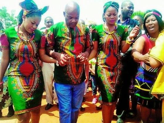 South African twin, Owami and Olwethu Mzazi with their Husband, Mzukiseni Mzazi (Photo Credit: Drum Magazine)